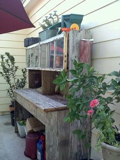 my husband built this from shabby fence boards, and old windows cut down..its serves both as potting bench and extra outdoor buffet