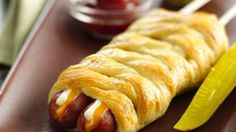 We love our hometown so much we created the Twin Cities Dog: Two hot dogs with double cheese (two kinds, of course), wrapped in Crescents and served on (yep, you guessed it) two sticks.