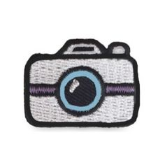 """Our silver camera hipstapatch™ is an embroidered fabric patch that measures approximately 1"""" x 1"""" with a peel-and-stick adhesive backing. Stick it on your shoes, hat, backpack, cellphone case, camera,"""
