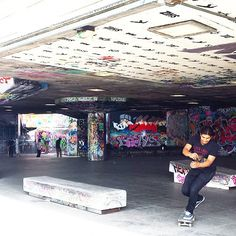 Southbank skatepark on the River Thames in London. Covered in graffiti, it is one of the best places in London to watch people skate park.
