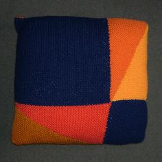 The Other Two Sides - Cushion demonstrating Pythagoras' Theorem with the back showing a different arrangement of the same shapes (In 12 Pillows of Wisdom)