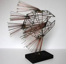 Znalezione obrazy dla zapytania fish sculpture metal