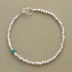 "*******SINGULAR MOMENT BRACELET  Item No. 57013	$148.00  A single rondelle of turquoise makes a surprise appearance among faceted sterling silver nuggets in a bracelet you'll want to wear every day. Made in USA. Exclusive. Approx. 7-1/4""L."