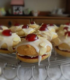 Bakewell Whoopie Pies - A British take on  whoopies made with almond cake, raspberry jam, marshmallow cream, and almond icing. Sounds divine!
