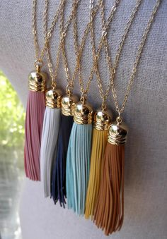Turquoise Leather Tassel Necklace with Long Gold Chain. $36.00, via Etsy.