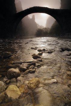 Bridge over rushing waters
