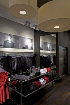 Dynamic lamp shades in womens clothing area.