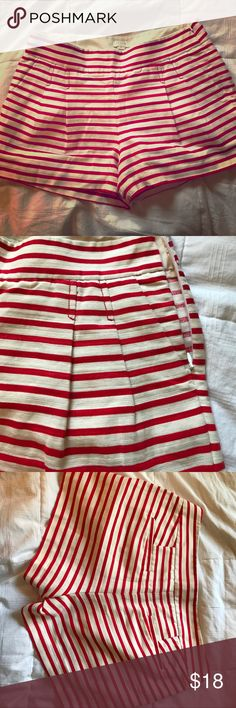 """J. Crew Red and White Striped Pleated Shorts Really cute Shorts; Red and White; Zip Side Close; Pockets on front and back may be opened (still sewn shut, but when opened have great pockets); Pleats on front so they flare out a bit, 3"""" inseam, 12"""" top to bottom, leg bottom 13"""" wide, 16"""" waist. Excellent Condition! J. Crew Shorts"""