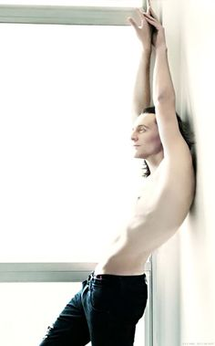 Tom Hiddleston. There is something so completely and utterly SEXY about his pose in this photo... I mean *honestly*... WOO!