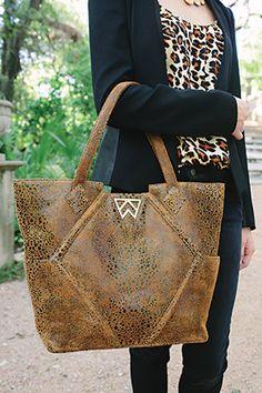Kelly Wynne, Ole Miss graduate. Beautiful handbags!