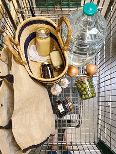 Zero waste grocery shopping using glass jars, a basket, and produce bags