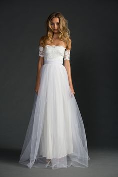 Made for the free spirits, Sally is such a gorgeous dress that is both fun and beautiful to wear and a dress everyone will remember. Featuring a strapless bodice made from beautiful stretch French lace and lace scallop detail, with unique lace arm bands thatstretch on separately. The soft Italian tulle skirt adds a luminescent …