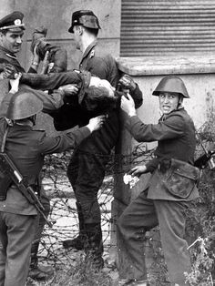 The body of Peter Fechter is recovered after being shot trying to cross the Berlin Wall into the West. Fechter lay in No Mans Land for two days, bleeding to death Checkpoint Charlie, East Germany, Berlin Germany, Ddr Brd, Berlin Hauptstadt, Rda, Music For Studying, Berlin Wall, German Army