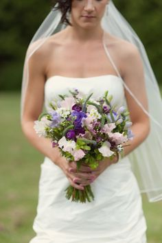 Your bouquet could be something like this.  That way, even though the bm's will be in teal, your purple won't be so overwhelming as to seem misplaced