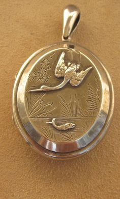 Victorian Sterling Locket Aesthetic Movement with Bird and Fish