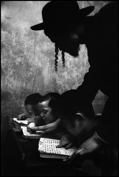 Bygone Americana (hebrew lesson in brooklyn. new york,1955.  by cornell capa)  Beautiful, beautiful image.  This is a very different teacher than the Russian Ballet instructor.  He is involved, close, and - I sense by the children's comfort with his proximity - gentle.  The silhouette face, hat, and earlocks are amazing.