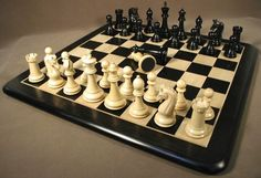 Chess set with double queens rounded corner board. www.thegamesupply.com/woodenchesssets