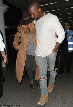 Feeling shy: Kim Kardashian kept her head down as she and Kanye West arrived in London on Saturday