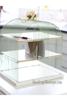 Upcycled Birdcage Desk Organizer By The Salvaged BoutiqueWhether you're really into that Sia music video or just looking for a more attractive way to store your mail, this birdcage desk organizer is a must-make. #refinery29 http://www.refinery29.com/back-to-school-diy#slide-8