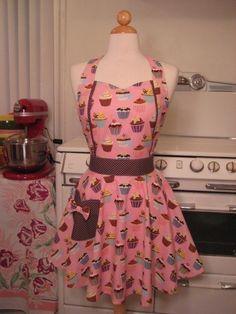 I love cupcake aprons (then I match my kitchen) :)