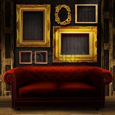 Gallery display vintage gold frames on an old timber wall and red sofa Stock Photo