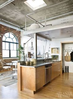 concrete ceiling loft | Concrete ceilings and ductwork were left bare in designer Elizabeth ...