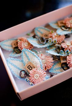 Scrabble boutonnieres.  Ha.  This makes me think of having board game tables instead of table numbers: the Clue table, the Scrabble table, the Monopoly table, etc.  Tables would be decorated in a normal fashion, but each table would have that one particular board game incorporated into the tablescape for the guests to play. Entertainment. :)