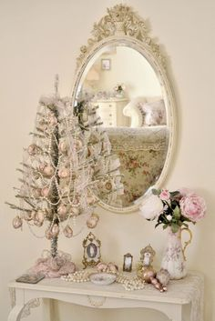 Mini tree in pink & white with pearls for garland. This would be pretty with vintage jewelry, too.