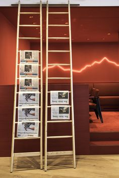 A rock hanging from the ceiling and a ladder that's a newspaper stand are some of the quirks inside Saltz, a restaurant designed by artist Rolf Sachs Zurich, Rolf Sachs, Newspaper Stand, Neon, Grand Hotel, Restaurant Design, Interior, Retail, Artists