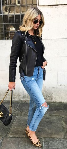 #fall #outfits women's black leather zip-up jacket and distressed washed blue jeans attire