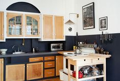 sneak peek: raymond biesinger and elizabeth hudson.  Chalkboard paint zones-off the kitchen, and we replaced a gross and obstructive particle-board island with this little IKEA wooden cart. We needed space to cook, schmooze, eat, serve and visit, not an ugly behemoth to hit our toes against. We spend a lot of time in the kitchen, and it tends to change a lot.