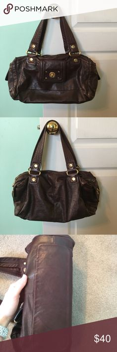 Marc Jacobs Purse Brown leather with signs of wear on exterior like scratches and on front near clasp there is a mark. Interior is in great shape. Marc by Marc Jacobs Bags