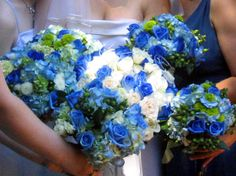 Balance this deep blue shade with lighter colors, such as white, green, or yellow, as this bride did.