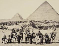 Sands of time: The Royal party pictured in front of the Pyramids of Giza in March 1862 with the then 20-year-old Prince of Wales sitting in a light jacket and cap on the third standing camel from left
