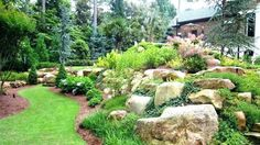 Hillside Landscaping With Boulders. Be inspired by pictures and guides for making the most of your garden, patio and decking. Hillside Landscaping With Boulders Make your neighbours jealous with a beautiful and nice green lawn on your property. Landscaping Berm Ideas, Landscaping With Boulders, Large Backyard Landscaping, Natural Landscaping, Backyard Ideas, Landscaping With Large Rocks, Mulch Ideas, Desert Backyard, Inexpensive Landscaping