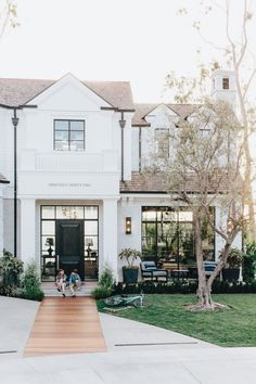 Customized exterior of a home. Pathway, address number, extra large front door handle, black window framing