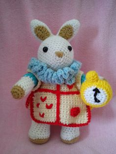 """On my niece's first birthday, I opted to surprise her with an amigurumi of Alice and the White Rabbit from the story """"Alice in Wonderland""""...."""