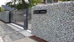 Gabion wall used as privacy wall & contemporary gate
