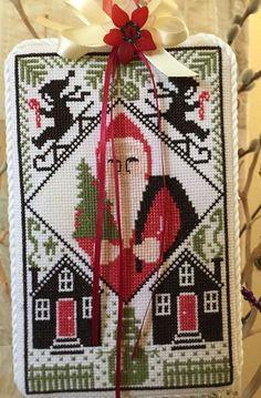 completed cross stitch Prairie Schooler Christmas Santa ornament door hanger