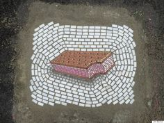 Artist Jim Bachor Fixes Chicago Potholes With Ice Cream Mosaics