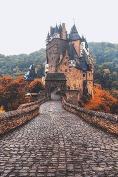 fairytale orange. charming castle in autumn.