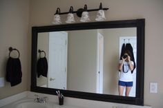 Spruce up your ugly bathroom mirror with these easy steps - no saw needed!!