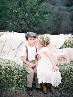 Flower Girl and Ring Bearer on Hay Bales | photography by http://featherandstone.com.au/
