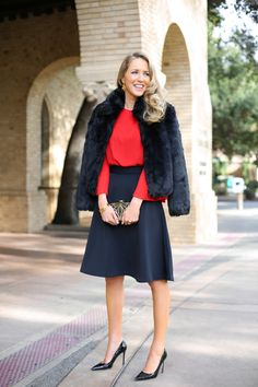 red blouse with A-line skirt and fur coat