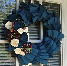 Denim wreath, but it seems like you could do it with any canvas-y fabric!   add more red and white flowers and it could be a wreath for the Fourth, Labor Day, Flag Day, and Memorial Day.