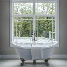 Spa-like bathroom with a free standing claw foot tub, glass enclosed dual shower head, rain shower, dual sinks and vanities. Listed in Vienna, VA for $1,599,999 by The Casey Samson Team, a Wall Street Journal Top Team in Northern Virginia.