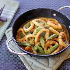 Squid and Okra Stir Fried in Curry Powder - 3 pcs squid, sliced into rings, 300g okra, 2 tbsp curry powder, 1 small red onion minced, 3 cloves garlic minced, oil, salt, water