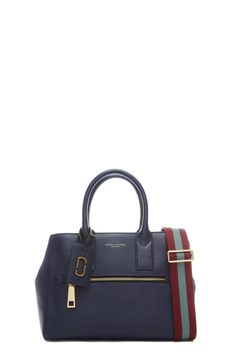 The Marc Jacobs Gotham Leather Tote Bag mixes refined leather with a sporty…