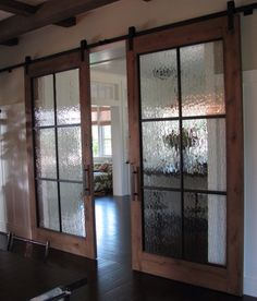 Beautiful sliding doors with glass for between a dining room and living room