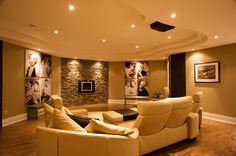 Signature theater kalispell contemporary basement and basement entertainment center family room fireplace home theatre stone Home Theater Screens, Home Theater Speakers, Home Theater Rooms, Home Theater Projectors, Home Theater Design, Screen Design, Basement Entertainment Center, Entertainment Ideas, Small Finished Basements